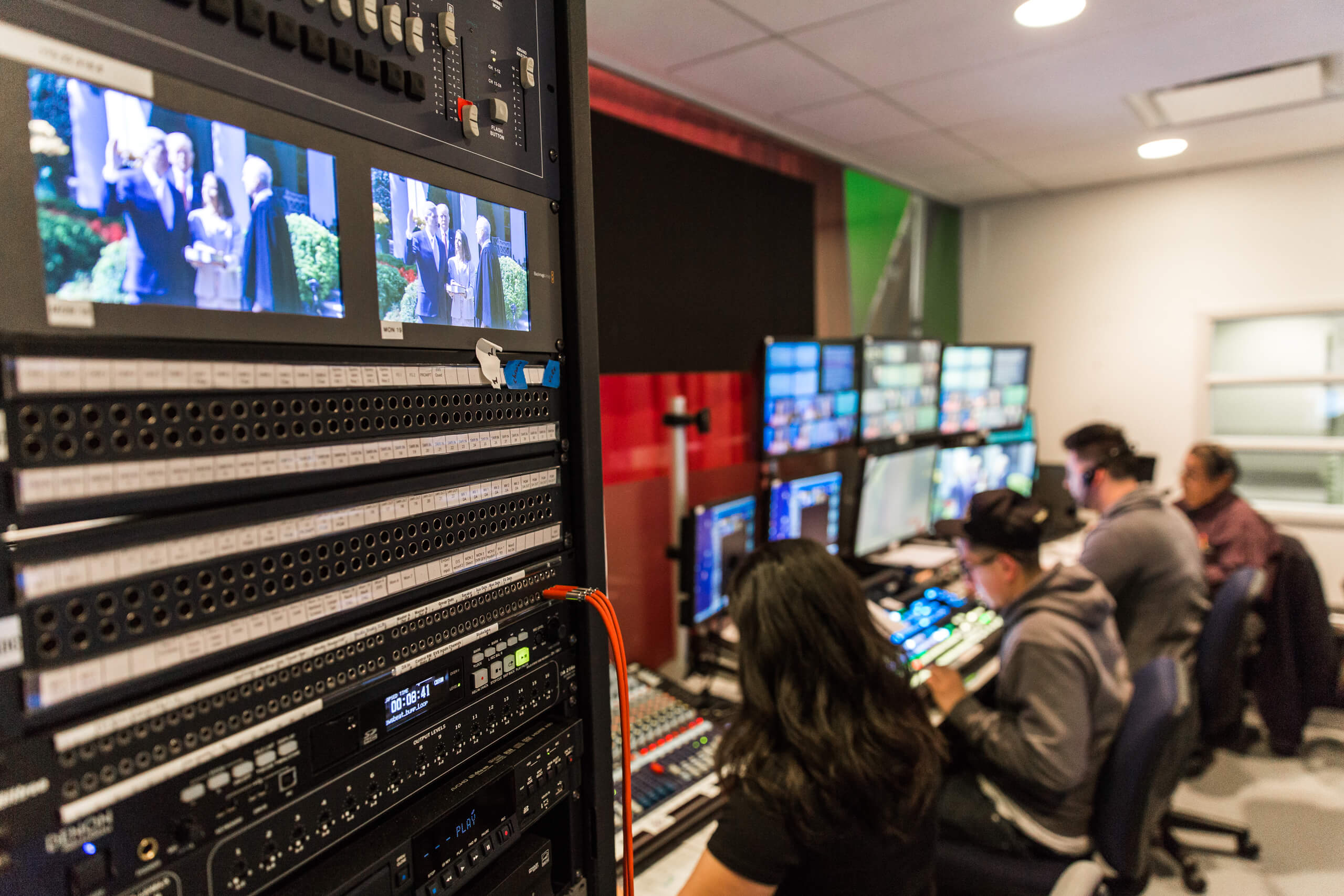students in tv newsroom control room
