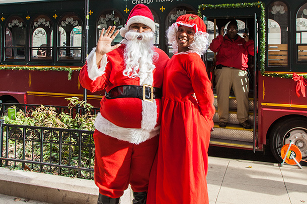 Mr. and Mrs. Claus visit the Holly Jolly Trolley