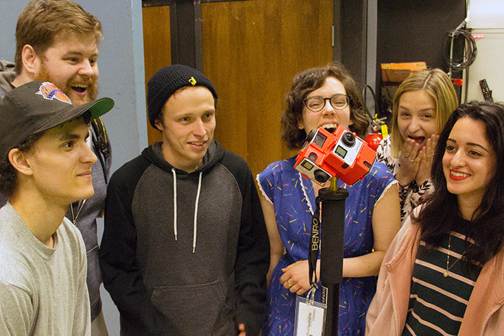 Six students looking at six GoPro cameras rigged to capture a 360 degree view. Photo courtesy of Mat Rappaport