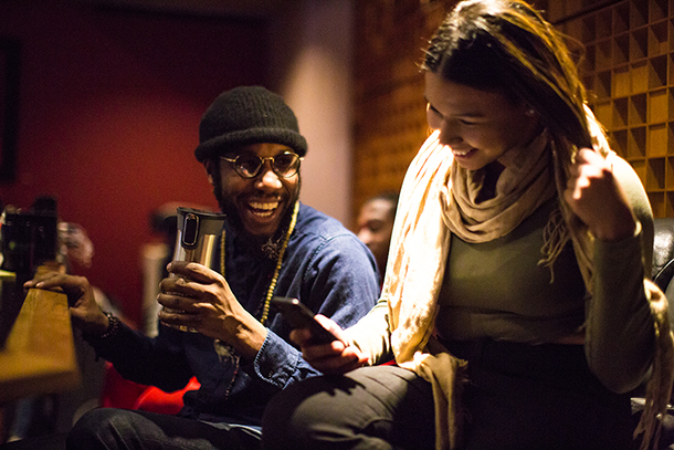 Cory Henry with a student