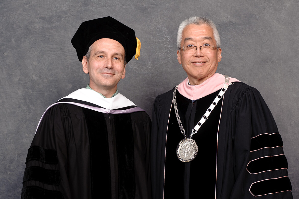 David Cromer HDR '17 (left) stands with President and CEO Dr. Kwang-Wu Kim (right) during the 2017 Columbia College Chicago Commencement. Photo: Robert Kusel