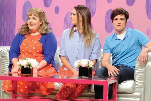 "Aidy Bryant, left, and Cecily Strong (pictured with Josh Hutcherson) write for and star in SNL's recurring sketch ""Girlfriends Talk Show."""