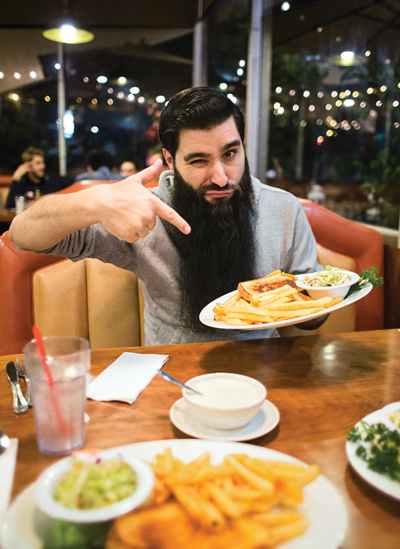 Jordan vogt-roberts enjoys a grilled cheese at Astro Diner in Los Angeles