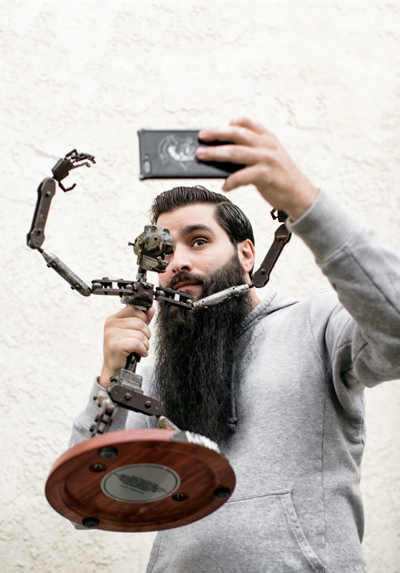 jordan vogt-roberts takes a selfie with one of the original King Kong armitures
